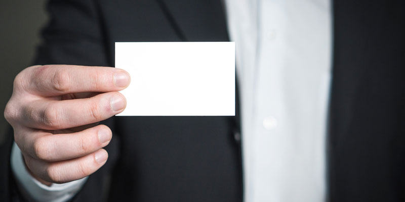 close-up of hand holding blank business card