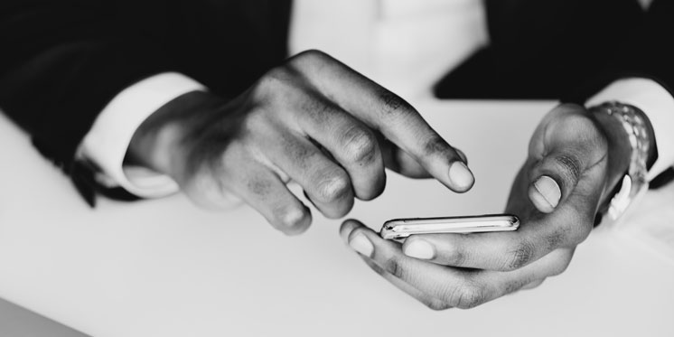 businessperson's hands holding phone