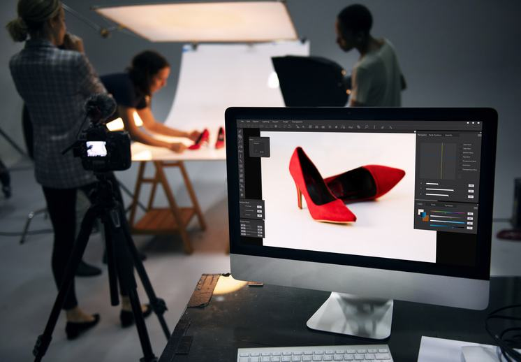 photographers taking pictures of shoes to use for online marketing