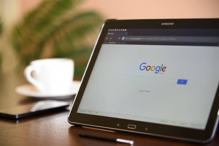 search engine google homepage open on tablet