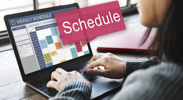 small business owner scheduling social media posts using a social media management dashboard