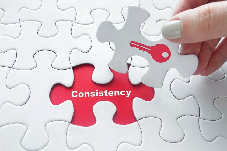 puzzle showing consistency is key to marketing success